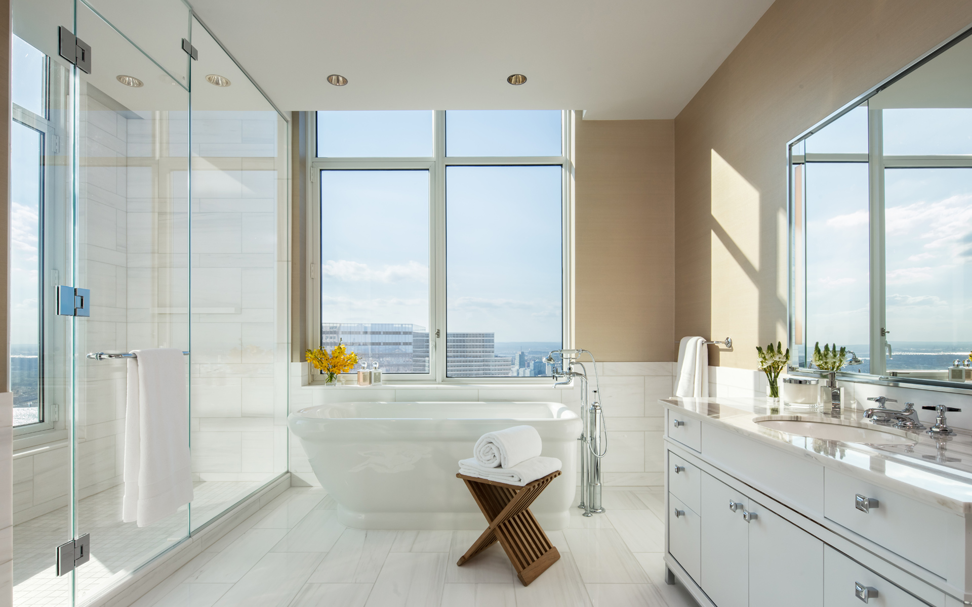 Chinchilla Mink and Bianco Dolomite marble adorn the master bathrooms with Robert A.M. Stern designed vanities. V