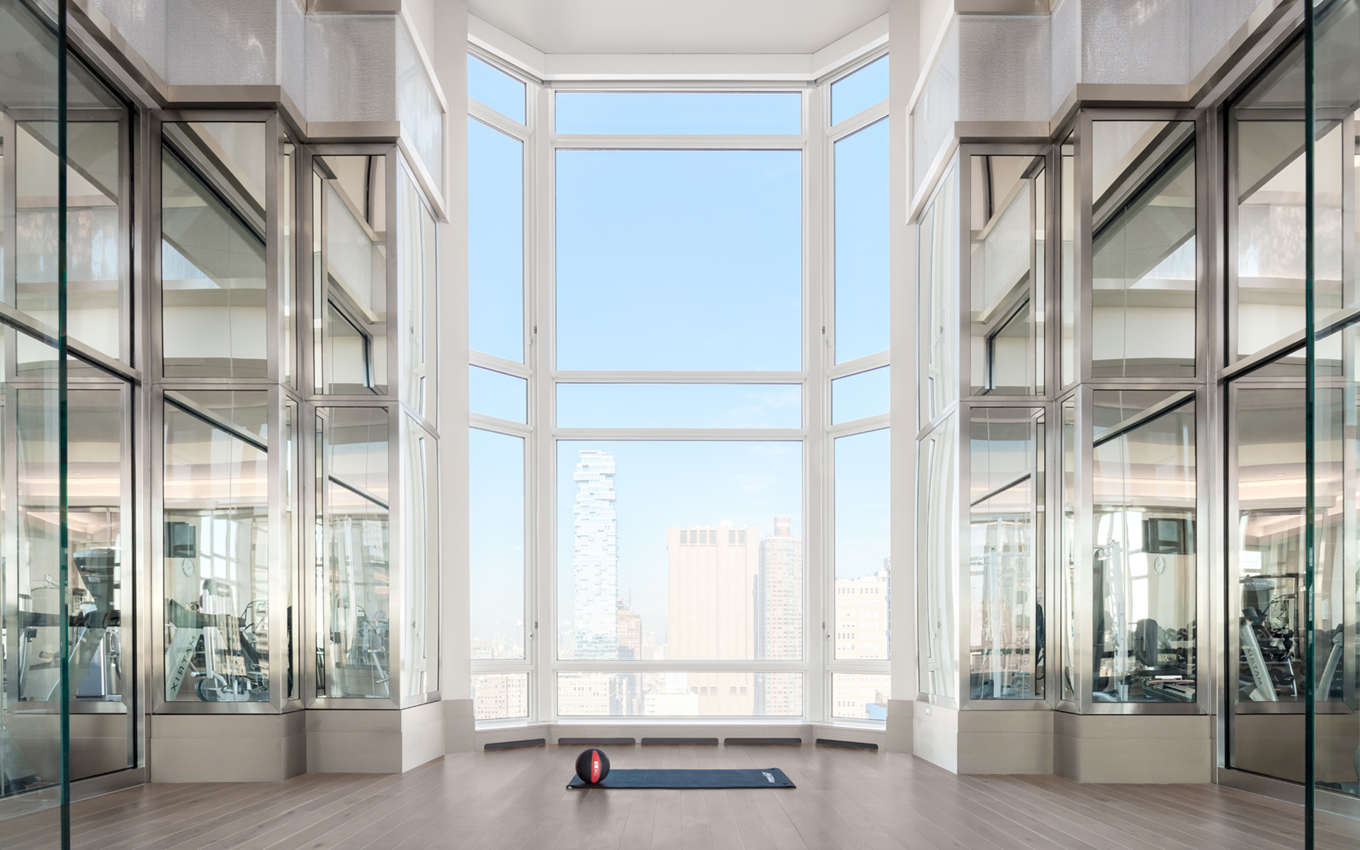 Exhilarating views of Manhattan, state-of-the-art equipment, and a glass-walled yoga studio.