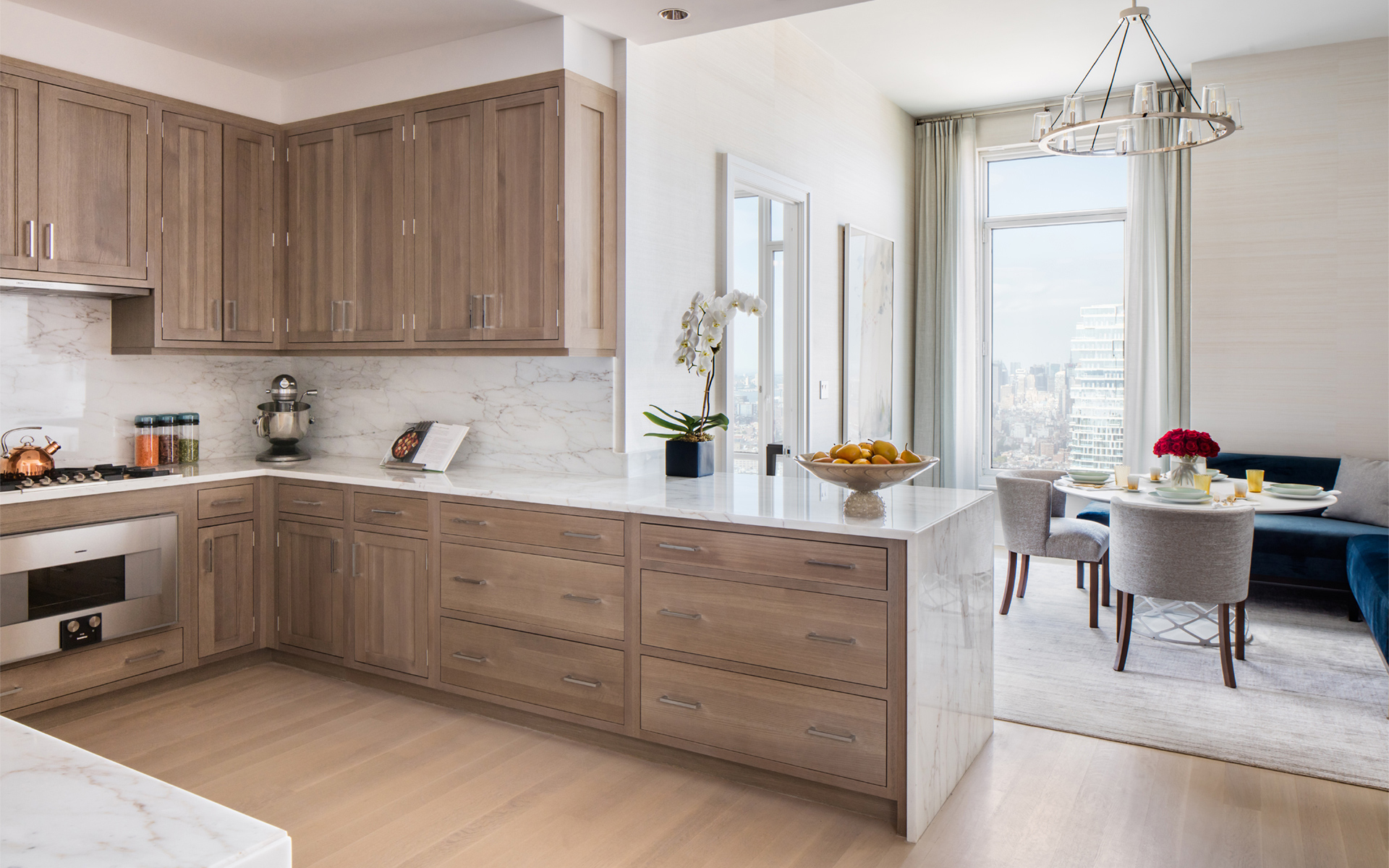 Solid white oak cabinetry by Bilotta, Colorado White marble countertop and backsplash, and appliances by Gaggenau, all with a spectacular view.