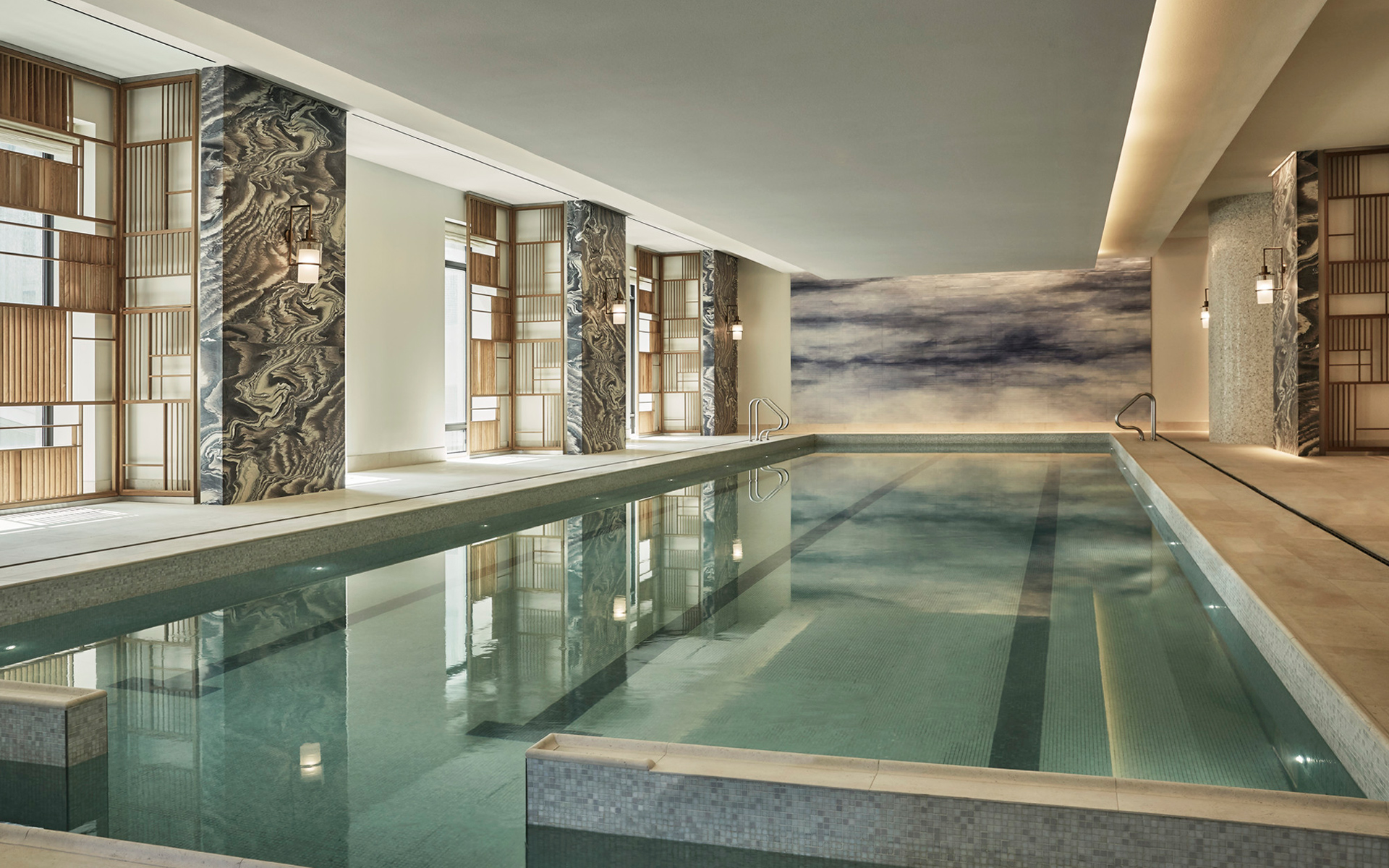 At 30 Park Place, handsomely appointed amenities serve as an extension of your own home and include a sunlit 75-foot pool with adjacent steam rooms and luxurious Four Seasons spa.