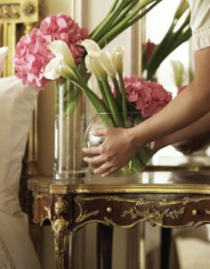 Placing a vase with flowers on a table