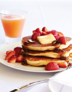 Pancakes served with juice